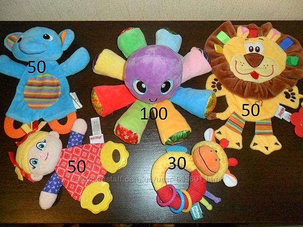 Яркие фирменные развивающие текстильные игрушки шуршат пищат звенят