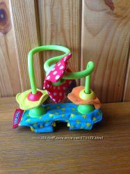 Игрушка Tinylove крепится на коляску