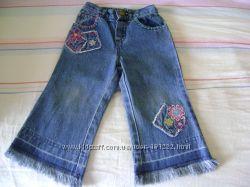 джинсы с бахромой