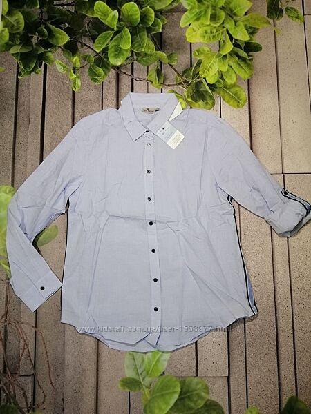 Стильная женская рубашка свободного кроя голубая