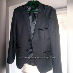 Школьный пиджак для мальчика Paulo Carvelli. Серый, рост 140, сост. нового