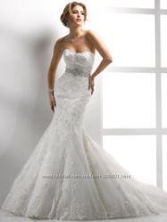 свадебные платья, а также реставрация и подгонка  свадебных платьев