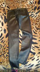 Стильные модные кожаные брюки.