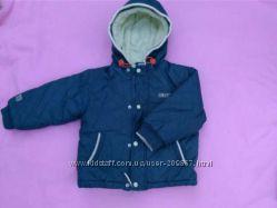 Куртка зимняя на мальчишку ростом 86 см.