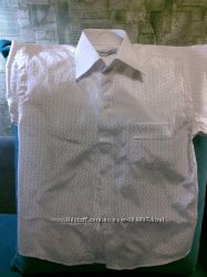 Рубашка белая на мальчишку 10 лет.