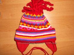 Теплая вязаная шапочка.
