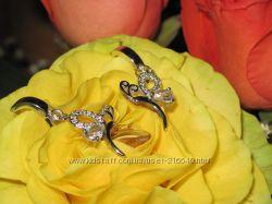Серебряное кольцо с фианитами и серьги с цирконами