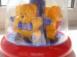 Развивающая игрушка юла- карусель TOLO