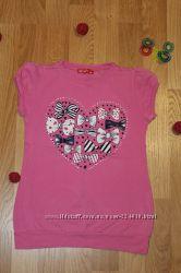 Нежно-розовая футболка