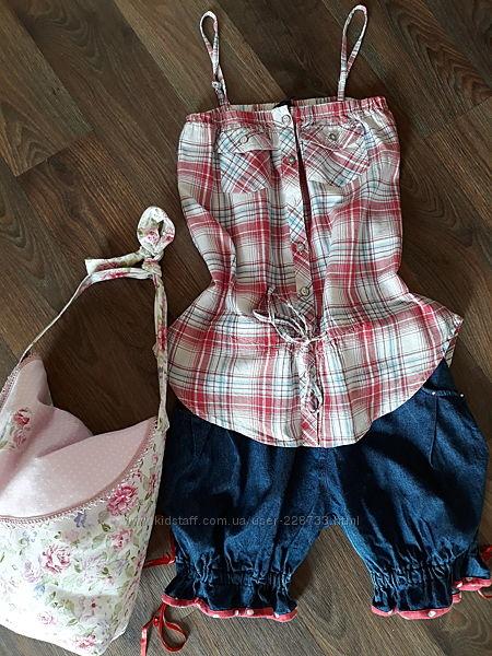 Фирменный комплект шортиков и блузки на девочку.