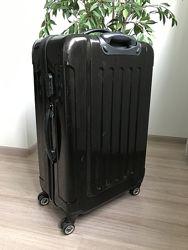 Высококачественный чемодан из поликарбоната SOLO SPAIN  на 4 колёсиках