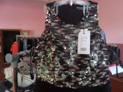 Брендовая одежда  на вес  цена 22 евро за кг.