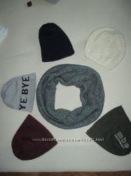 Очень много шапок и шарфов