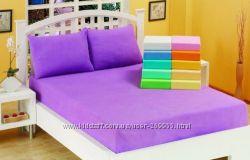 Разноцветные махровые и трикотажные простыни на резинке