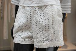 Белые ажурные шорты H&M.